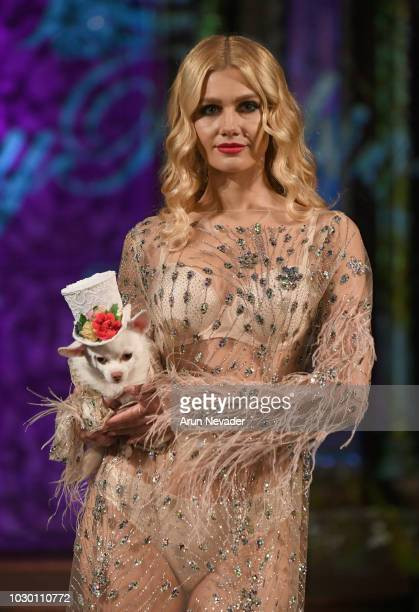 A model and dog walk the runway during the ANTHONY RUBIO show at New York Fashion Week Powered By Art Hearts Fashion at The Angel Orensanz Foundation...