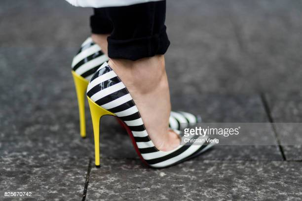 Model and fashion blogger Alexandra Lapp shoe detail wearing destroyed Adriano Goldschmied high waist denim in black black and white So Kate pumps...