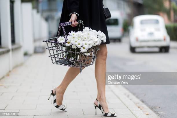 Model and fashion blogger Alexandra Lapp wearing a black shirt dress from Steffen Schraut Celine Audrey sunglasses flower satin slingback pumps with...