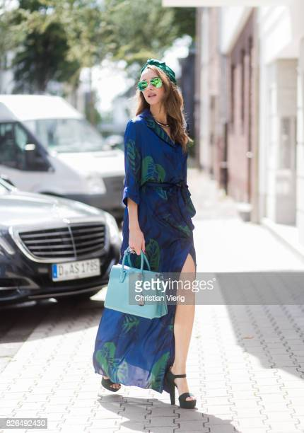 Model and fashion blogger Alexandra Lapp wearing a blue Kimono maxi dress with green leaf print from Borgo de Nor green metallic Aviator sunglasses...