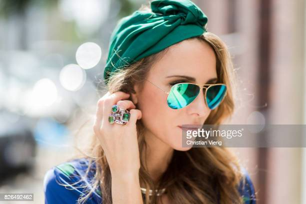 Model and fashion blogger Alexandra Lapp wearing a blue Kimono maxi dress with green leaf print from Borgo de Nor green metallic Aviator sunglasses...