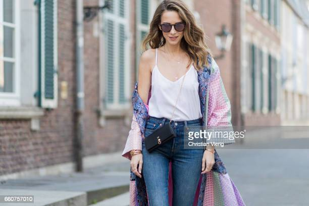 Model and fashion blogger Alexandra Lapp wearing a printed kimono / panel robe from Natasha Zinko slim fit high waist Jeans from Rag Bone Mules by...