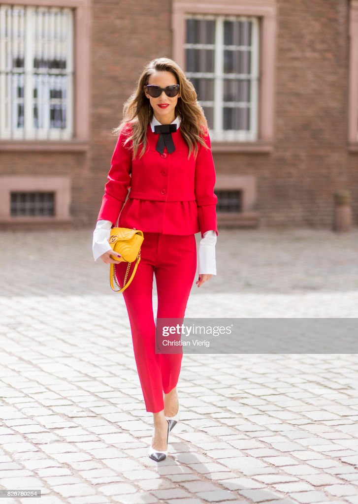 Model and fashion blogger Alexandra Lapp wearing a red slim fit suit from Steffen  Schraut,