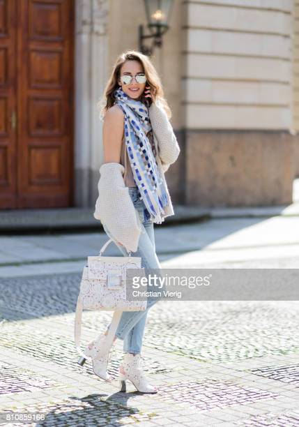 Model and fashion blogger Alexandra Lapp wearing a scarf and beige cashmere cardigan by Heartbreaker beige tank top in silk from Jadicted a high...