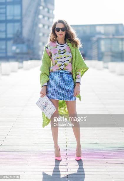 Model and fashion blogger Alexandra Lapp wearing a sequin skirt by Ashish stole / shawl and pullover made of cashmere from Heartbreaker black...