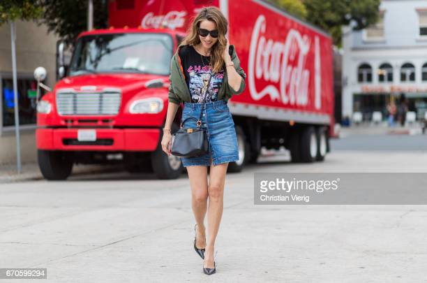 Model and fashion blogger Alexandra Lapp wearing a TShirt from ECNTRC with a Karl Lagerfeld lookalike of Eddie the Head monster of the band Iron...