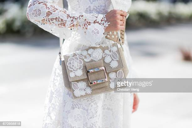 Model and fashion blogger Alexandra Lapp wearing a white Zouze dress waist belt in beige and white leather from Azzedine Alaia white sandals from...