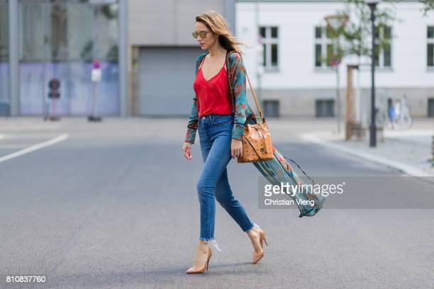 Model and fashion blogger Alexandra Lapp wearing a wrap dress in Kimono style from Zara, silk tank top from Jadicted, petite bucket bag from MCM,...