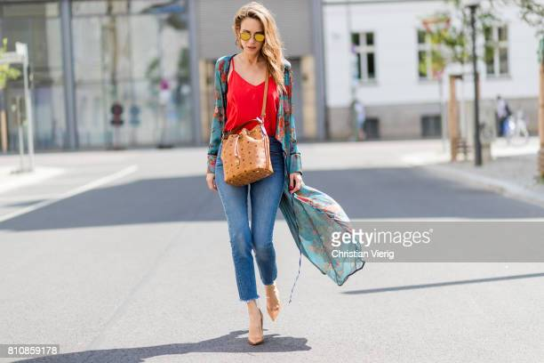 Model and fashion blogger Alexandra Lapp wearing a wrap dress in Kimono style from Zara silk tank top from Jadicted petite bucket bag from MCM Levis...