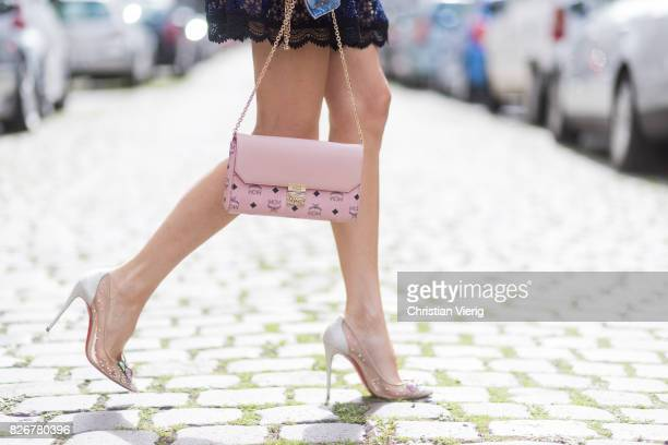 Model and fashion blogger Alexandra Lapp wearing Christian Louboutin Feerica heels with Swarovski crystals and flower accessory and Millie crossbody...