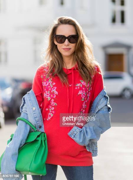 Model and fashion blogger Alexandra Lapp wearing colorblocking oversized denim jacket by SET high waist denim from Rag and Bone Jeans red cashmere...
