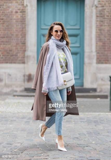 Model and fashion blogger Alexandra Lapp wearing colorful cashmere pullover by Heartbreaker high waist fivepocket 501 skinny jeans from Levis pajama...