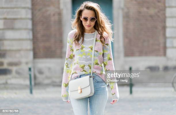 Model and fashion blogger Alexandra Lapp wearing colorful cashmere pullover by Heartbreaker high waist fivepocket 501 skinny jeans from Levis...
