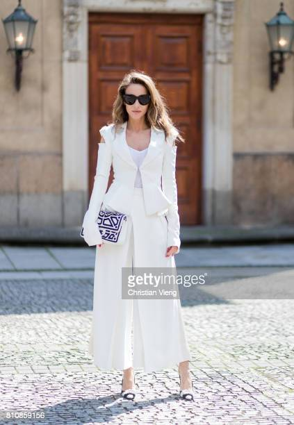 Model and fashion blogger Alexandra Lapp wearing culottes and blazer from Michalsky in white Celine Audrey sunglasses Roger Vivier satin slingback...