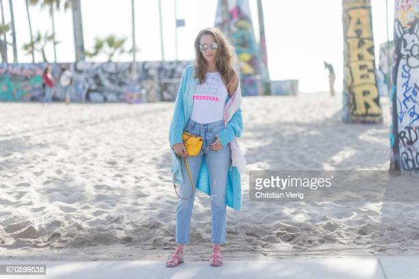 Model and fashion blogger Alexandra Lapp wearing Levis skinny jeans in light blue with a vintage optic a body from Patrizia Pepe in sensitive white...