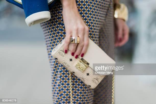 Model and fashion blogger Alexandra Lapp wearing pajama style silk blouse and pants from Steffen Schraut blue Balenciaga blazer jacket Millie cross...
