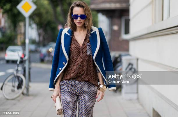 Model and fashion blogger Alexandra Lapp wearing pajama style silk blouse and pants from Steffen Schraut blue Balenciaga blazer jacket blue lacquer...