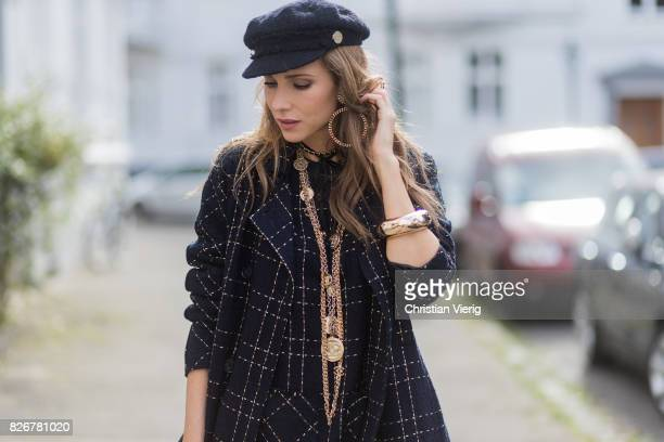 Model and fashion blogger Alexandra Lapp wearing tweed dress and coat from Steffen Schraut, Balmain x HM sandals, Strak backpack by MCM, Chanel tweed...