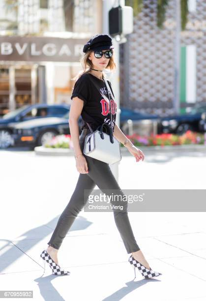 Model and fashion blogger Alexandra Lapp wearing wearing a LACE FRONT SKINNY LEATHER PANTS by Unravel Dior High Voltage TShirt from Ecntrc black and...