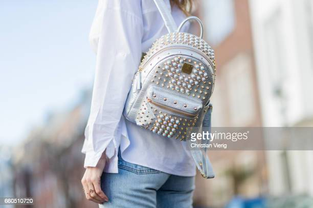 Model and fashion blogger Alexandra Lapp wearing wearing a white shirt from Steffen Schraut Levi's 501 skinny jeans brown mules with a shiny buckle...