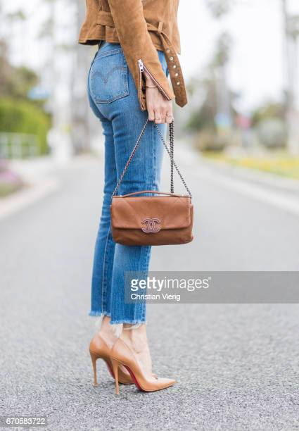 Model and fashion blogger Alexandra Lapp wearing Wedgie Icon Fit jeans slim fit in dark blue by Levi's washed rose cotton YSL USA cropped Tshirt from...
