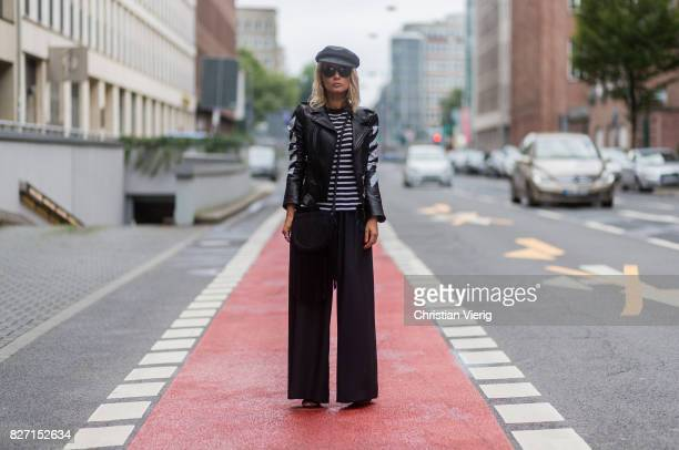 Model and fashion blogger Gitta Banko wearing a black leather jacket by Off White black and white stripped viscoselinen mixture top by Alexander Wang...