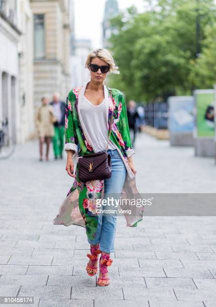 Model and fashion blogger Gitta Banko wearing a green floralpatterned kimono from Zara a white tshirt by James Perse anklelength jeans from Rag Bone...