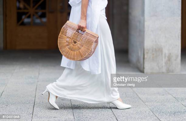 Model and fashion blogger Gitta Banko wearing a white silk top by Jadicted white oversized blouse by Balossa a figurehugging white silk skirt by...