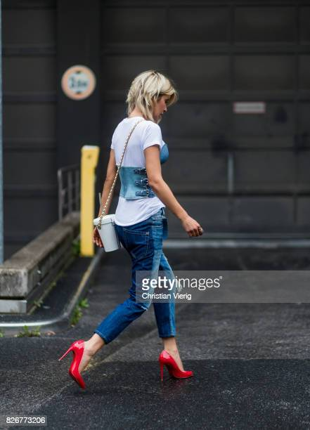 Model and fashion blogger Gitta Banko wearing white tshirt by James Perse under a demin corsage by Marina Hoermanseder Anglomania Diagonal Zip jeans...