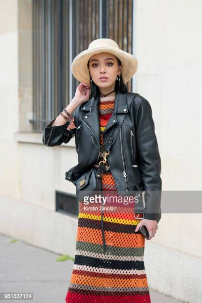 Model and fashion blogger Kiwi Lee han wears a Dior dress bag and jacket day 2 of Paris Womens Fashion Week Spring/Summer 2018 on February 27 2018 in...