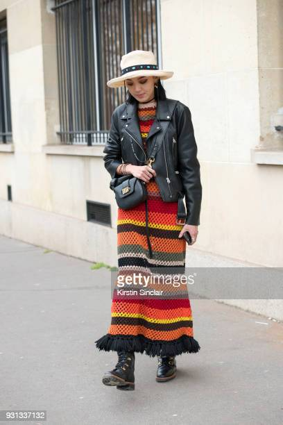 Model and fashion blogger Kiwi Lee han wears a Dior dress boots bag and jacket day 2 of Paris Womens Fashion Week Spring/Summer 2018 on February 27...