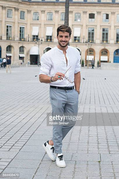 Model and Fashion blogger Mario Divaio wears a Louis Vuitton shirt and trousers Rolex watch and Divaio MDV shoes on day 3 of Paris Collections Men on...