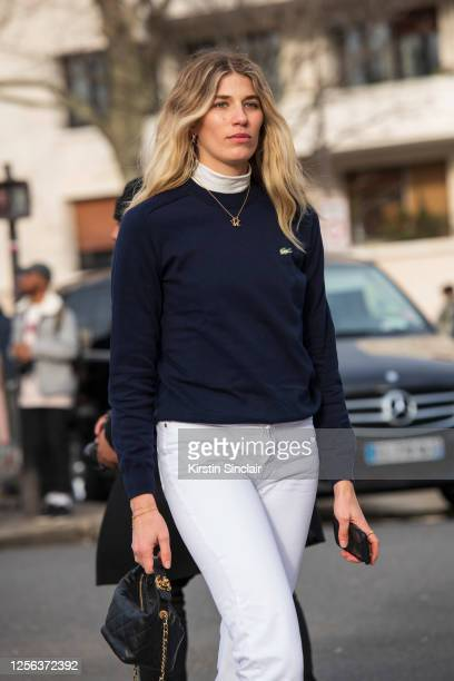 Model and fashion consultant Veronika Heilbrunner wears a Lacoste jumper and jeans and a Chanel bag on March 03, 2020 in Paris, France.