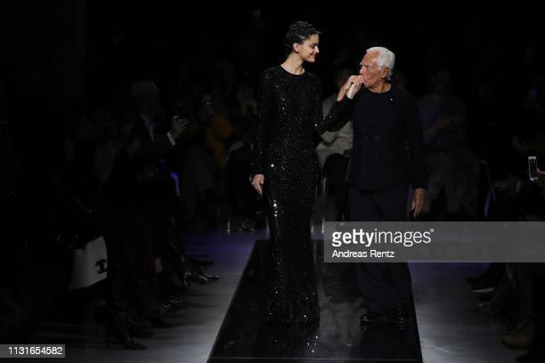 A model and fashion designer Giorgio Armani acknowledge the applause of the audience after Giorgio Armani show at Milan Fashion Week Autumn/Winter...