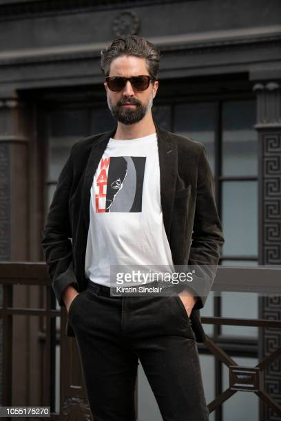 Model and Founder of Queer Bible Jack Guinness wears an Alexa Chung T shirt during London Fashion Week September 2018 on September 15 2018 in London...