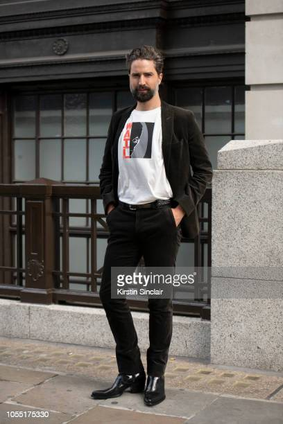 Model and Founder of Queer Bible Jack Guinness wears an Alexa Chung T shirt and Calvin Klein boots during London Fashion Week September 2018 on...
