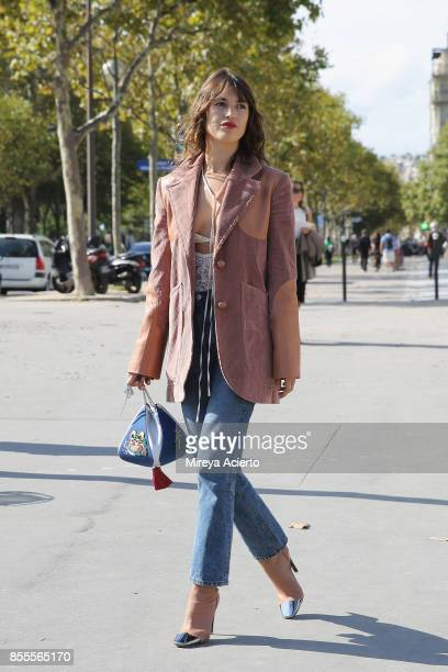 Model and founder of Rouje Jeanne Damas attends the Nina Ricci show as part of the Paris Fashion Week Womenswear Spring/Summer 2018 on September 29...