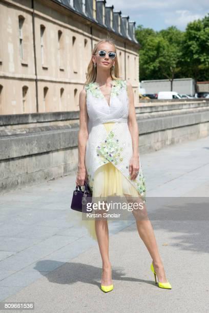 Model and Founder of Vaara active wear Tatiana Korsakova wears a Delpozo dress Dior bag jewellery and sunglasses Duccio Venturi shoes day 2 of Paris...