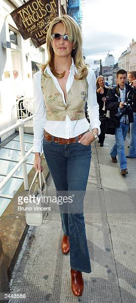 Model and girlfriend of singer Rod Stewart Penny Lancaster walks out of a hair dressers prior to the photocall for Ultimo on August 29, 2003 in...