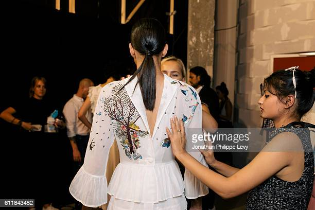 Model and guests pose prior the Rahul Mishra show as part of the Paris Fashion Week Womenswear Spring/Summer 2017 on October 1 2016 in Paris France