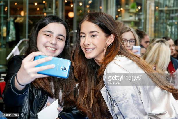 Model and influencer Brenda Huebscher with a fan during the 'Die Schluempfe Das verlorene Dorf' premiere at Sony Centre on April 2 2017 in Berlin...