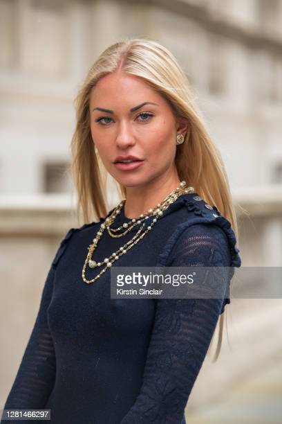 Model and Influencer Lexi Fargo wears a Chanel dress, necklace and earrings during LFW September 2020 at on September 20, 2020 in London, England.