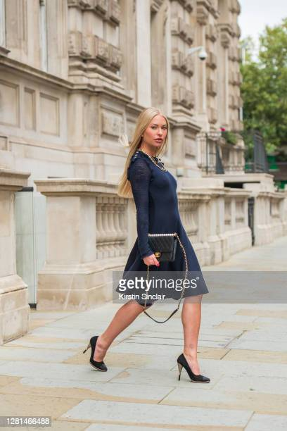 Model and Influencer Lexi Fargo wears a Chanel dress, necklace, bag, earrings and shoes during LFW September 2020 at on September 20, 2020 in London,...