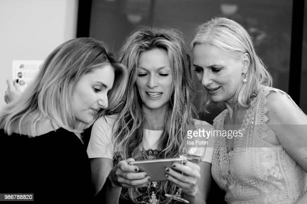 Model and influencer Marie von den Benken performance artist Mia Florentine Weiss and model Petra van Bremen during the Emotion Award at Curio Haus...