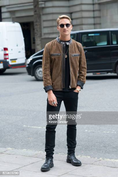 Model and Made in Chelsea star Oliver Proudlock wears Paige jeans Diesel boots Zara T shirt Belstaff jacket Specsavers sunglasses on day 3 of London...