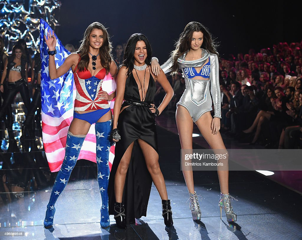 Model and new Victoria's Secret Angel Taylor Hill from Illinois (L) and model Megan Puleri from Ohio (R) walk the runway while singer Selena Gomez performs during the 2015 Victoria's Secret Fashion Show at Lexington Avenue Armory on November 10, 2015 in New York City.