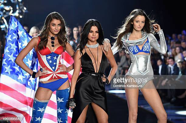 Model and new Victoria's Secret Angel Taylor Hill from Illinois and model Megan Puleri from Ohio walk the runway while singer Selena Gomez performs...