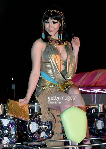 Model and parade queen Claire Sinclair rides in the MisterFusion Artcar during the fourth annual Las Vegas Halloween Parade on October 31 2013 in Las...