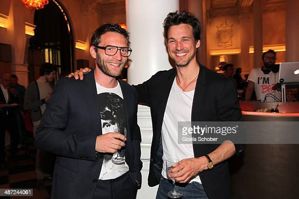 Model and personal trainer Matthias Haun and Florian David Fitz attend the BMW Open Players Night at Rilano No 6 on April 28 2014 in Munich Germany