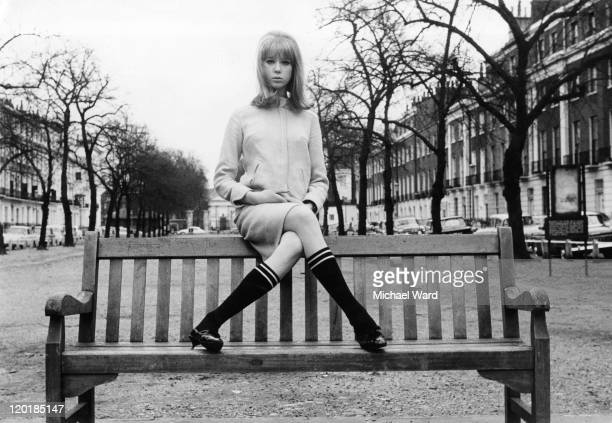 Model and photograher Pattie Boyd posing on a park bench, 1964. Boyd was married to George Harrison and Eric Claption.